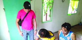 Antidrug officers inspect items seized from Roger Dela Cruz. Dela Cruz was nabbed in an entrapment operation in Barangay Alijis, Bacolod City. POLICE STATION 8/ BCPO