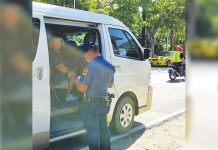 Personnel of the Malay municipal police station flag down this vehicle at a border control checkpoint here. The local government unit put up checkpoints in the boundaries of the town to lessen the risk of spreading the corona virus disease 2019 (COVID-19). MALAY AKLAN PNP
