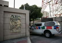 A media crew cab enters the ABS-CBN Broadcasting Center, the office of the country's top broadcast network, following a move by the Philippine government to scrap its franchises, in Quezon City, Feb. 10, 2020. Reuters