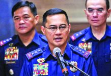 """The 357 police officers on the list will be given a chance, I have asked the President for time for the PNP to validate and evaluate the list,"" says Philippine National Police chief Archie Gamboa (center). GMA NEWS"