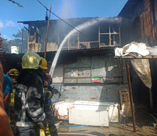 Firemen spray with water this house that fire struck in Barangay Tanza Esperanza, Iloilo City on Sunday, Feb. 23. The fire gutted a total of eight houses , four of which were totally destroyed. IAN PAUL CORDERO/PN