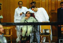 Former Egyptian president Hosni Mubarak, who faced multiple charges after his overthrow, including over the deaths of protesters in 2011 and for corruption, appeared with his two sons Alaa (R) and Gamal at their trial in Cairo in September 2013. AFP