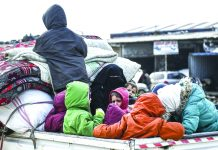 Civilians flee from Idlib toward the north to find safety inside Syria near the border with Turkey, Saturday, Feb. 15, 2020. Syrian troops are waging an offensive in the last rebel stronghold. AP