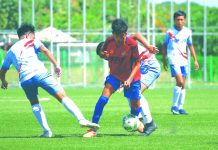 A Negros Occidental player carves for space against opposing defenders. PFF