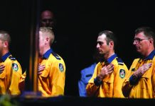 New South Wales Rural Fire Service personnel attend a state memorial honouring victims of the Australian bushfires at Qudos Bank Arena in Sydney, New South Wales, Australia, Feb. 23, 2020. REUTERS