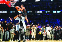 Orlando Magic's Aaron Gordon soars past seven-foot-five Boston Celtics center Tacko Fall for his final trick of the 2020 All-Star Slam Dunk competition in Chicago, USA on Feb. 15. YAHOO SPORTS