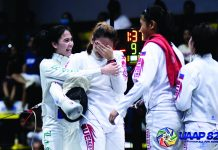 Players of the University of the East Lady Warriors epee team are in tears after clinching the women's overall championship. UAAP