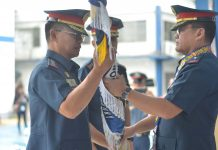 CHANGE OF COMMAND. Police Colonel Eric Dampal (left) formally takes over as director of the Iloilo City Police Office during a change of command presided by Police Brigadier General Rene Pamuspusan (right), Western Visayas police director, on Feb. 20, 2020. Looking on (partly hidden) is Dampal's predecessor, Police Colonel Martin Defensor, now the chief of the Directorial Staff, Police Regional Office 6. IAN PAUL CORDERO/PN