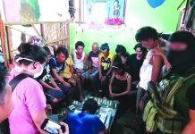 Antidrug officers inspect items seized from 16 drug suspects in Barangay 6, San Carlos City, Negros Occidental on Feb. 25. PDEA REGION VI