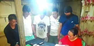 An antidrug officer inspects items seized from John Rey Tayucon, Dexter Dagatan, Elesaldie Cadalman and Mark Bille. The suspects were arrested in an entrapment operation in Barangay Villamonte, Bacolod City on Feb. 7. POLICE STATION 2/ BCPO