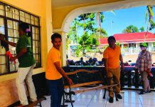 Employees of the local government unit of Caluya, Antique disinfect their municipal hall as one of the preventive measures against the coronavirus disease 2019. MUNICIPALITY OF CALUYA