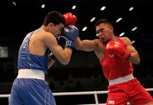 Filipino Eumir Marcial lands a punch on Abilkham Amankul of Kazakhstan. PHOTO COURTESY OF JORDAN OLYMPIC COMMITTEE