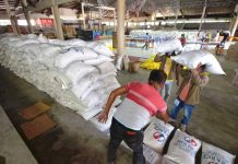 At the Jaro district gymnasium, personnel of the Iloilo City Government prepare these sacks of rice donated by the private sector for repacking and distribution to residents economically displaced by the enhanced community quarantine being observed to stop the spread of the coronavirus disease 2019. IAN PAUL CORDERO/PN