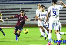 University of the Philippines Fighting Maroons' Anton Guariña (No.23) tries to evade defenders of the National University Bulldogs during the two teams' showdown in the University Athletic Association of the Philippines Season 82 Men's Football.University of the Philippines Fighting Maroons' Anton Guariña (No.23) tries to evade defenders of the National University Bulldogs during the two teams' showdown in the University Athletic Association of the Philippines Season 82 Men's Football.