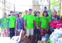 Member-agrarian reform beneficiaries (ARB) of the Nazareth Farmworkers Association in Barangay Purisima, Manapla, Negros Occidental prepare essential goods and financial aid to be distributed to its members and other ARBs in their area on March 26. They are one of the ARB organizations in this province to do so amid the coronavirus disease 2019 pandemic. DAR NEGROS OCCIDENTAL I-NORTH