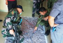 Police Colonel Paul Kenneth Lucas (left), director of the Iloilo Police Provincial Office, traces the treat path of rebels who attacked Philippine Army troops in Barangay Panuran, Lambunao, Iloilo on April 7, 2020. IAN PAUL CORDERO/PN